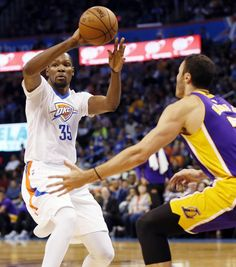 Oklahoma City's Kevin Durant (35) passes away from Los Angeles' Larry Nance Jr. (7) during an NBA basketball game between the Oklahoma City Thunder and the Los Angeles Lakers at Chesapeake Energy Arena in Oklahoma City, Saturday, Dec. 19, 2015. Photo by Nate Billings, The Oklahoman