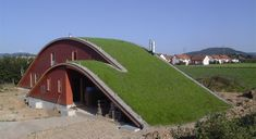 living roof on a red barn - an amazing combination of modern design and practicality