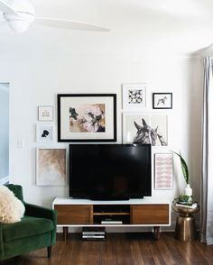 The gallery wall with the TV