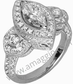 Marquise diamond with halo and two side stones and millgrain.   #marquisediamondengagementring #halosetting #diamondsinhouston #diamondengagementring Houston Diamond Outlet in Houston, TX