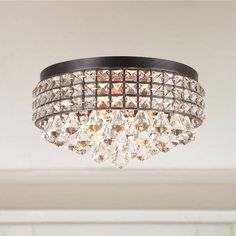 Light up your room with a bit of sophistication using the Jolie iron shade crystal chandelier. Featuring an antique black finish with a light brush of brown, this flush mount treasure will scatter lig