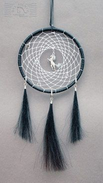 Simple black leather bound dreamcatcher with three horse hair tassles 18cm diameter
