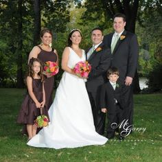 For her fall wedding this bride chose chocolate brown for her girls and black tuxes for the guys.  To add color there were pops of raspberry, orange and lime green in the bouquets and pomander ball.  Pasquarella wedding, photo by McGarry Photography.