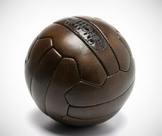 gearculture:  1950s Soccer Ball  Courtesy of French sporting company, John Woodbridge  Sons, is this 1950s Style Soccer Ball. Crafted from patinated leather, it features 18 panels and mimics the style of soccer balls used throughout the 1950s, as well as in the 1934/1938 World Cups.