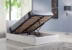 4ft6 White Faux Leather Ottoman Bed Frame - £259.95 - Our customer feedback on this model has been overhwelmingly positive. People can't believe they got such a good bed for such a low price. Give it a try, we are sure you won't be disappointed.  Features good quality sprung slats in 2 rows. Soft touch and realistic faux leather (not patterned cardboard type or PVC). Twin compressed gas lift system for easier lifting. Loads of storage space.