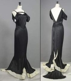 Chanel haute couture Cannes gown from circa 1935.The long black silk dress features a unique neckline and puffed sleeves hanging