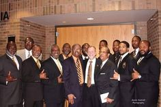 Brothers of Alpha Phi Alpha with President Dunn