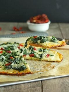 Cauliflower Crust Spinach White Pizza - omitting the cheese would qualify it as paleo...