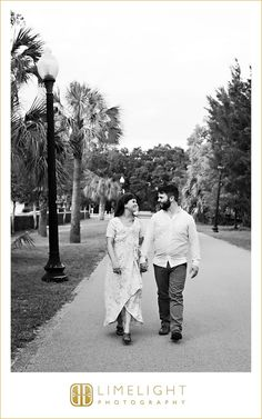 holding hands, outdoors, yellow, vintage, outdoor, international diamond center, engagement, engagement session, limelight photography, step into the limelight, boardwalk, pier, water, hugging, kissing, palm trees, ring, details, wedding, walking, black and white, streetlight
