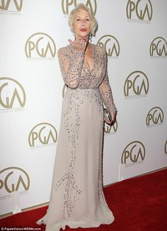 Shimmering in silver: Dame Helen Mirren blew a kiss on the red carpet as she posed in a stunning silver gown at the Producers Guild Awards at the Beverly Hilton in Beverly Hills on Sunday evening