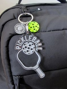 Show pickleball some love with this fun Pickleball paddle Keychain.  from Pickleball Xtra #pickleball #pickleballxtra #keychain #acrylic