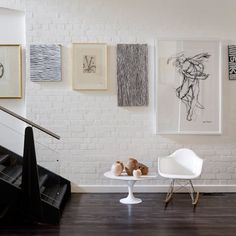 """We're often asked for the design rules of hanging artwork—and """"Center 57"""" is an easy guideline to follow if you want to get it right. It advises hanging art so that the center of each piece is 57 inches from the floor, ensuring that it's about eye-level for most people. However, some design rules are meant to broken. Here are seven spaces with bold arrangements that defy everything you've ever heard about hanging art—yet somehow still get it right."""