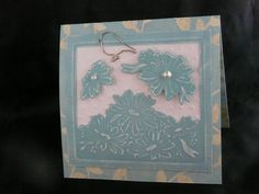 Spellbinders Die - cut, embossed and sanded with pearl accents and dotted swiss embossed background on patterned card stock with a paperclip bird accent.