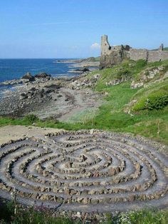 Dunure Castle and Labyrinth on Ayrshire coast, Scotland. According to Irish and English ancient legends the fairies danced on labyrinth spirals in the moonlight; in accordance to Norwegian popular beliefs stone rows made by ice-giants; by Swedish tales l Oh The Places You'll Go, Places To Travel, Places To Visit, Travel Destinations, Scottish Castles, Scotland Travel, Historical Sites, Dream Vacations, Beautiful Places