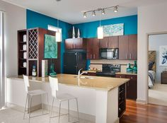 Create separation between your kitchen and dining areas with different colored walls.