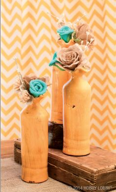 Find a pretty vase or bottle and tuck in a few whimsical burlap blooms for a lovely home accent.