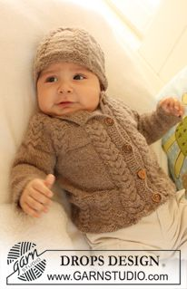 """Set comprises: Knitted DROPS jacket with raglan sleeves, hat and booties with cables in """"Alpaca"""". ~ DROPS Design"""