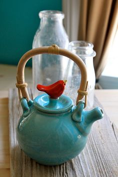 Beautiful turquoise ceramic teapot with cute bird lid
