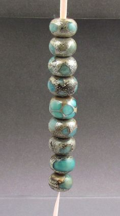beads....will try this look with polymer clay in turquoise, silver leaf and translucent