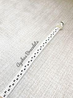 FREE BRACELET !! White and Black Miyuki Bracelet / Beaded Bracelet / Minimalist Style / Miyuki Bead Bracelet / Miyuki Delica by AyshasBracelets on Etsy https://www.etsy.com/uk/listing/580564238/white-and-black-miyuki-bracelet-beaded