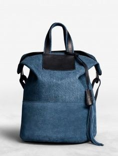 Acne Arden Denim is a bucket bag that can be carried or slung over the  shoulder. 7f900ef762004