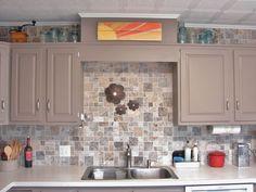 Kitchen Remodel on a Strict $1,000 Budget - like the stone look backsplash...