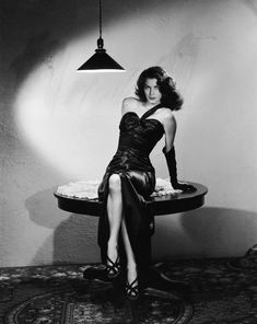 In stark surroundings American actress Ava Gardner poses in a sleek black satin dress in a scene from Robert Siodmak's film noir, 'The Killers'. Get premium, high resolution news photos at Getty Images Glamour Hollywoodien, Robes Glamour, Hollywood Glamour, Classic Hollywood, Old Hollywood, Hollywood Photo, Hollywood Wedding, Hollywood Icons, Vintage Glamour