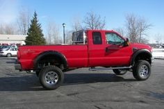 red lifted Ford truck