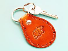 Click To Shop Now – Handmade Leather Keyring, Leather Keychain, Why not check out my Etsy shop? #bear #keyring #leather #keychain #animal #handstamped #birthdaygift #christmasgift Leather Bookmark, Leather Keyring, Leather Gifts, Leather Tooling, Leather Craft, Handmade Leather, Tooled Leather, Leather Jewelry, Leather Anniversary Gift