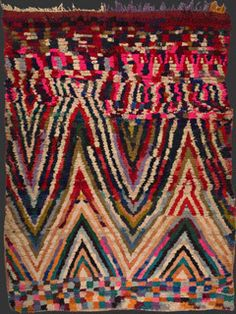 Boucherouite rug: Berbere women weave carpets out of discarded scraps of material. A thousand scraps of cotton, nylon and occasionally wool are woven into these fabulous decorative creations.    The contrast between the poverty of the materials used and the richness of the final composition adds to these awe-inspiring works of modern art.