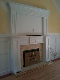 Dave Miller Interiors - Mansfield, MA, United States. Custom fireplace mantel and wainscoting in living room.