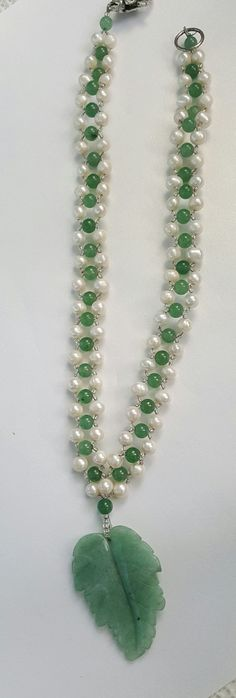 This necklace is sure to bring the compliments. The jade and freshwater pearls are woven for a lovely effect and the Aventurine leaf pendant adds the point of interest. The necklace is 19 with a lobster claw clasp and will work well with most necklines. Stones are said to have an
