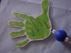 kushandje voor papa, met op achterzijde foto van de kleuter.