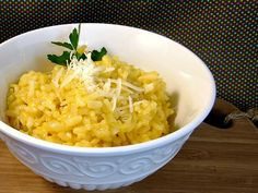 Ingredients 3 tablespoons butter 1 clove garlic, minced 1 small onion, chopped 1½ cups vegetable broth, plus extra if needed 1 cup uncooked Arborio rice ¾ cup white wine ¼ cup grated Asiago cheese