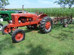 Allis Chalmers WD-45 with 3 bottom plow