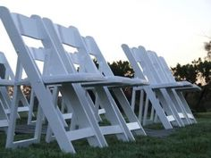 must have these type of white chairs for outdoor wedding http://destinbeachweddingchairs.com/category/white-wedding-chairs/