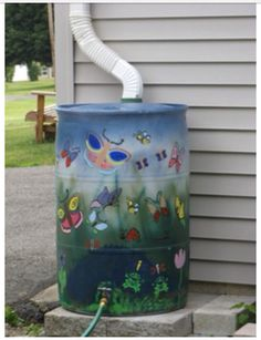 Painted water barrel to collect rain water