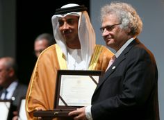 Renowned Lebanese author Amin Maalouf (R) receives the Sheikh Zayed Book Award 2016 for cultural personality of the year from UAE deputy Prime Minister Sheikh Mansour Bin Zayed at a ceremony in Abu Dhabi. Amin Maalouf, 4 May, April 4th, Photos Of The Week, Steve Jobs, Prime Minister, The Only Way, Abu Dhabi, Uae