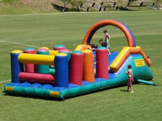Gladiator Obstacle - This popular interactive inflatable is ideal for the adventurous ones and is also great for team building. It consists of a slide with a combat net at the back of the slide, you climb up the back of the combat net and slide down the slide, then you clumber over and under inflatable obstacles on an inflatable bed. NOT to be used with water. Suitable for kids and adults. Inflatable Bed, Water Slides, Team Building, Playground, Castles, Popular, Adventure, Fun, Kids