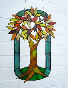 Autumn painted stained glass hanging panel.