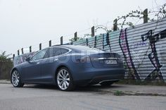 Blue Tesla seen from the side and behind | Stock Photo | Colourbox on Colourbox