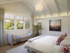 Nice White painted wood walls and ceiling enhance the modern farmhouse bedroom  - Modern Farmhouse Style - A Little Bit Country....A Little Bit Rock and Roll