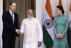 Formal: Prince William (left) shakes hands with Indian Prime Minister Narendra Modi as he ...