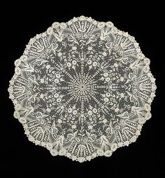 Parasol. Used for a very expensive parasol, this is a fine example of Belgian appliqué net lace worked in the form of a parasol cover. Parasol covers were made separately from the parasols and tacked on at the end of the manufacturing process.