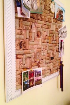 Put photos on the wine cork board for wall decoration.