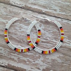 White sunburst Native American beaded hoop earrings by BuffaloGirlCreative on Etsy https://www.etsy.com/listing/218750342/white-sunburst-native-american-beaded