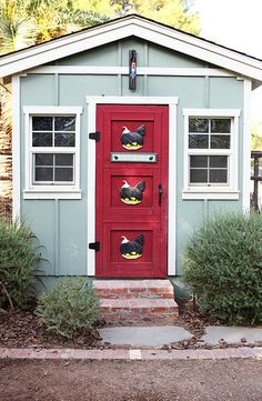 Love the red door with the chicken art