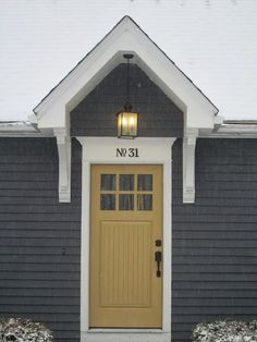 Door color to compliment SW drizzle new on shutters. More Cape Cod curb appeal Room Rx Portico Dark Grey Houses, Yellow Houses, Yellow Front Doors, Front Door Colors, Exterior Paint Colors For House, Paint Colors For Home, Paint Colours, Cape Cod Exterior, Exterior Front Doors