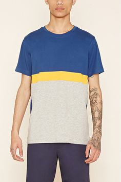 A cotton-blend knit tee with a ribbed crew neck, short sleeves, and a colorblock front.