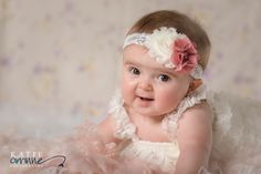 Cute girly ideas for 6 Month Milestone Portraits.  Baby girl studio photos in white ruffled romper.   Photography by Katie Corinne Photography Brynlee was so delightful for her 6 month milestone session! I seriously could not get enough of that baby chunk and all her fun expressions!